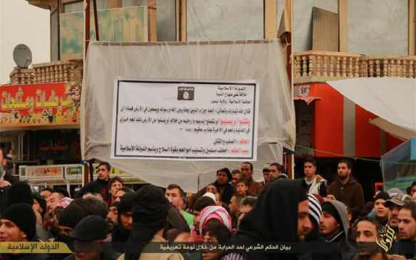 "Caption: ""The shari'a verdict for banditry is stated in an introductory sign"""