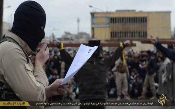 "Caption: ""Reading the statement of the shari'a verdict issued by the shari'a court in the state of Nineveh who robbed Muslims using the force of weapons"""