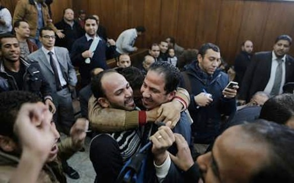 Families of defendants rejoice in the courtroom. Photo: Associated Press.