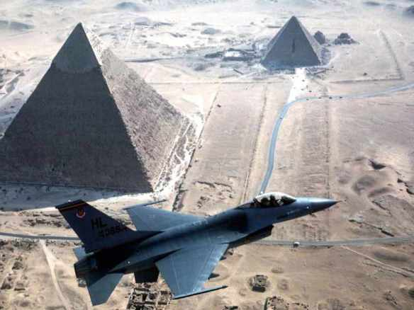 From Barack with love: American-bought F-16 jet over the pyramids. Photo from US Department of Defense, Defense Audiovisual Agency.
