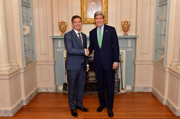 Kerry poses with Randy Berry, new special envoy on LGBT people's human rights, February 27. Photo: Department of State