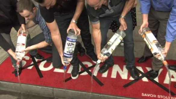 Politics is so draining: Bar-goers dump Stolichnaya at a West Hollywood protest, 2013. Photo from International Business Times