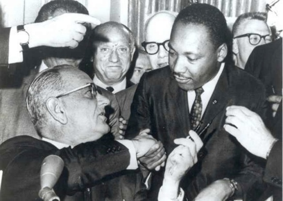 President Johnson hands a pen to Rev. Martin Luther King, Jr., after signing the Civil Rights Act, July 2, 1964
