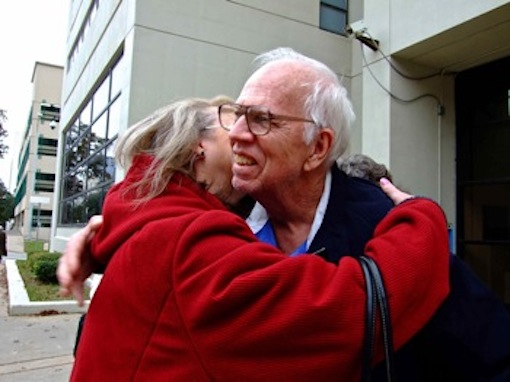 Fran and Dan Keller embrace outside the Travis County Jail on the day they were freed, December 2013. Photo by Debbie Nathan, who worked in their defense for years.