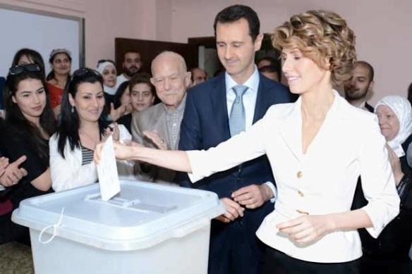 They all look so secular: this must be freedom! Bashar al-Assad and wife Asma vote in presidential election, 2003. Photo by Getty