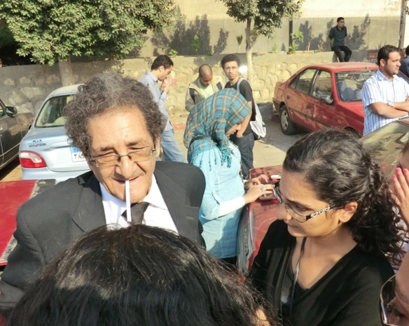 Seif and daughter Mona outside a military court in Cairo, October 30, 2011; Seif was defense attorney in one of his son Alaa's trials. Photo by Sherif Kouddous