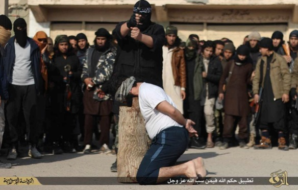 Man beheaded in Raqqa for blasphemy, December 2014. Photo from ISIS-affiliated social media