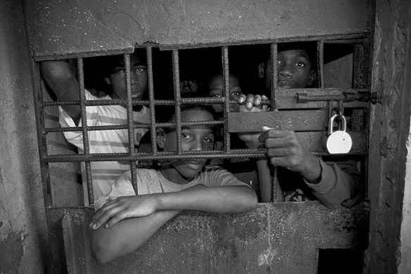 Young boys in a Jamaican prison cell, 2007. Photo © Gary S. Chapman, from www.garyschapman.com
