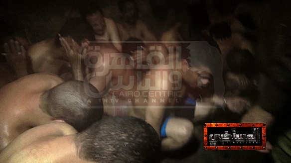 Photo taken and publicized by Egyptian journalist Mona Iraq, showing arrested victims of the 2014 Cairo bathhouse raid over which she presided