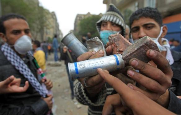 "Egyptian protesters point to the ""Made in USA"" tag on a tear gas canister used against them near Tahrir Square, November 20, 2011. Photo: Khaled Dessouki for AFP"