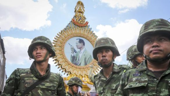 Thai soldiers gather under a portrait of the king following the 2014 coup: EPA/Diego Azubel